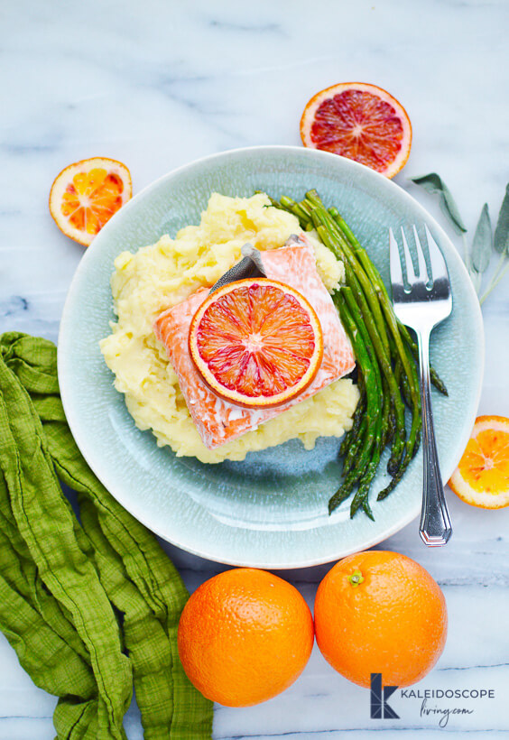 baked blood orange salmon on mashed potatoes with asparagus