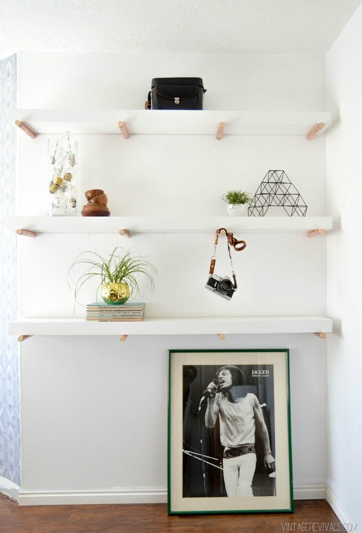 floating shelves with copper pegs