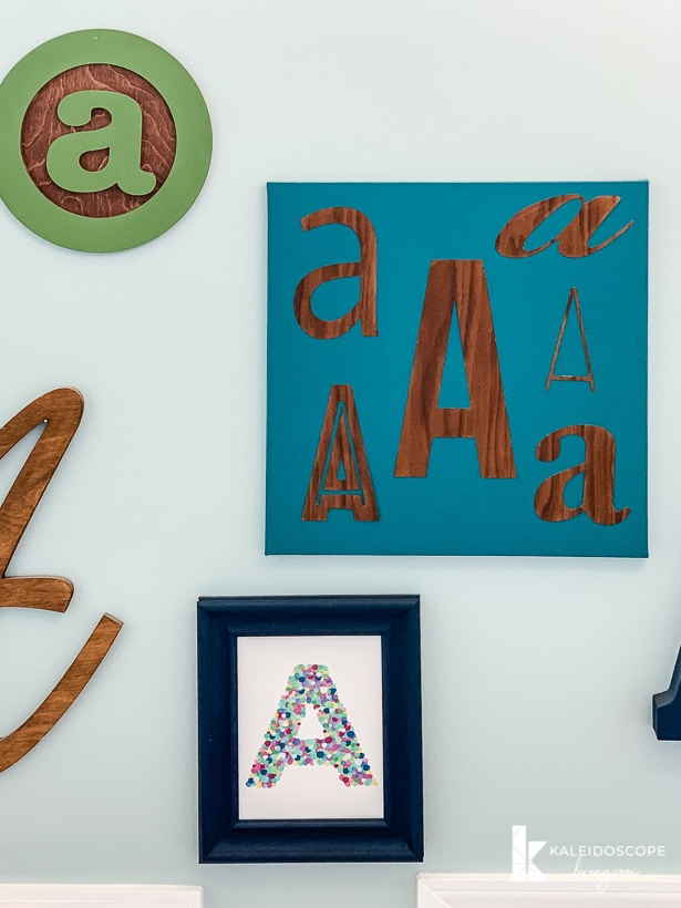DIY typography wall art hanging on wall