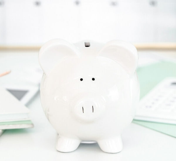 white piggy bank on desk