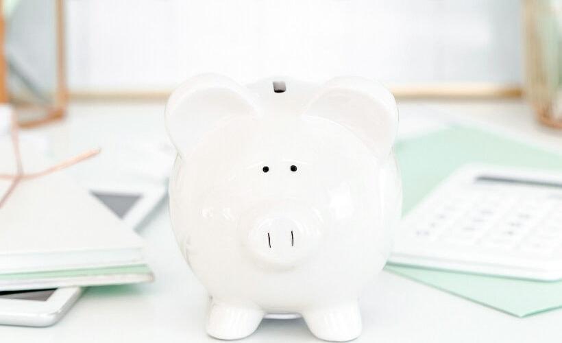 white piggy bank on desk