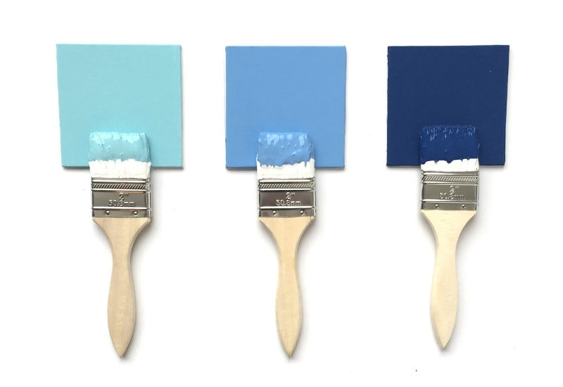 wet paint brushes and paint chips