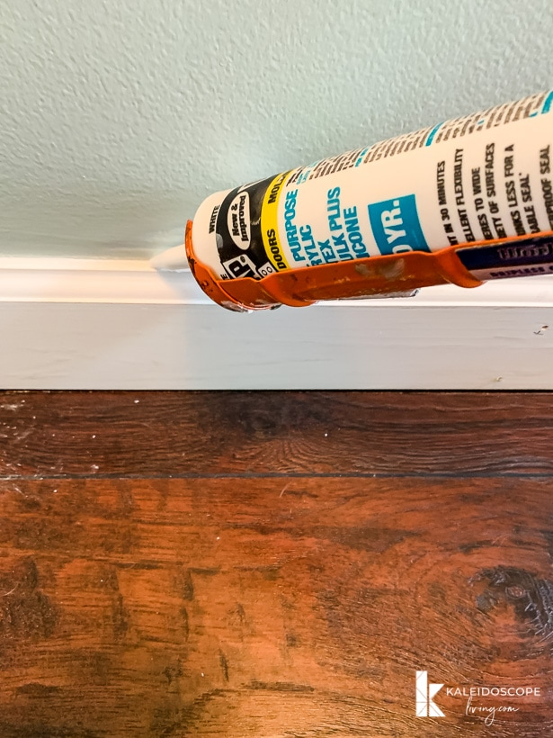 DAP Alex Plus caulking along baseboard