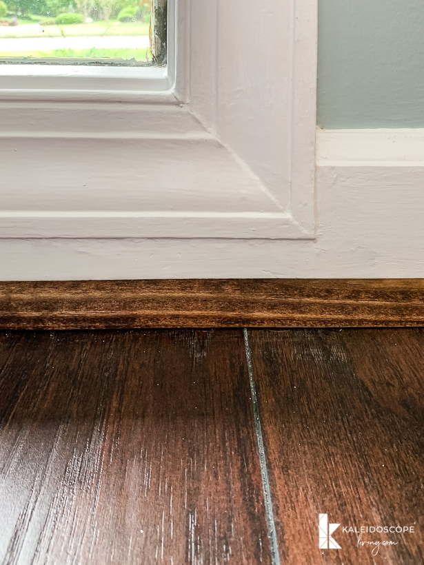 freshly repaired baseboard molding with quarter round