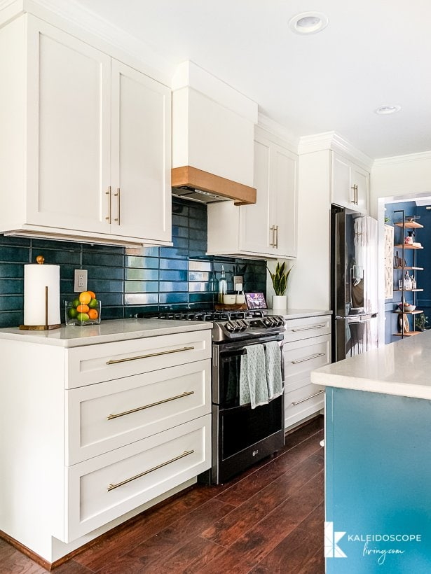 white and blue kitchen with diy range hood