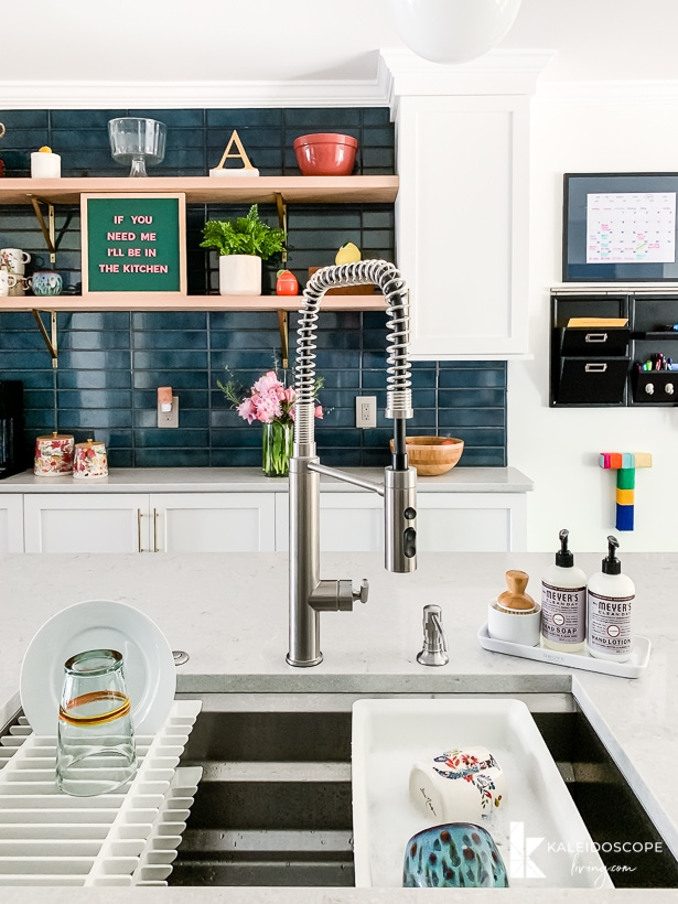kohler prolific sink in white and teal kitchen