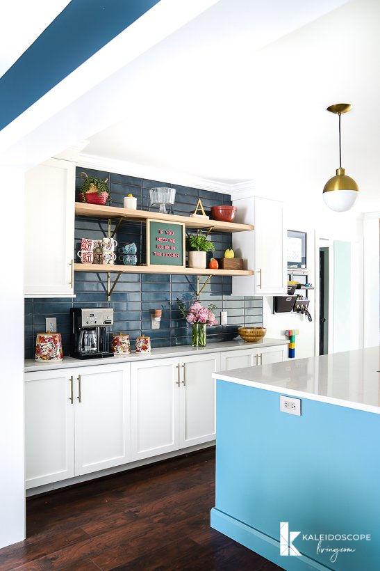 white and teal kitchen open to dining room