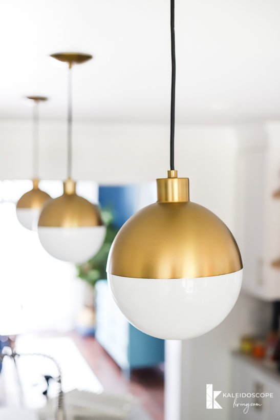 modern gold and white pendant lights in kitchen remodel