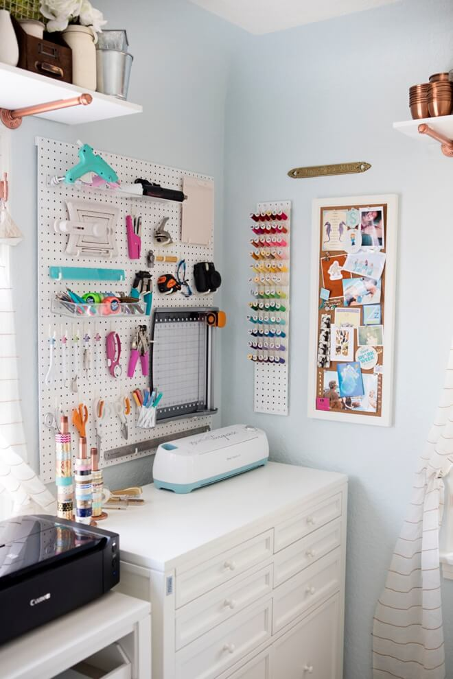 white craft room with bright pops