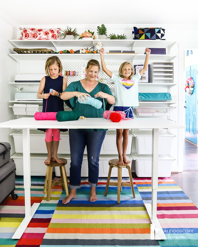 colorful craft room with IKEA Algot storage and standing table