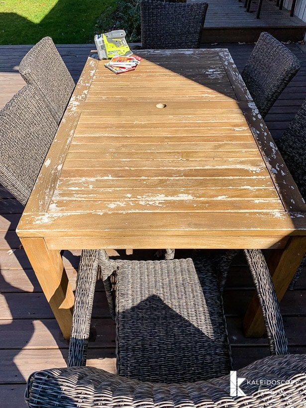 worn outdoor teak table