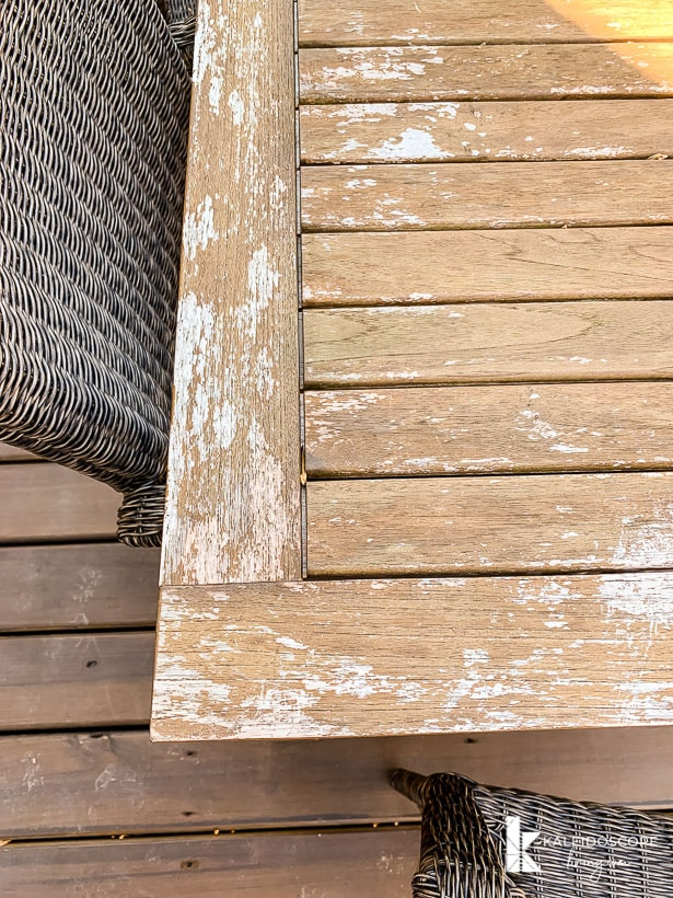 unevenly weathered teak outdoor table