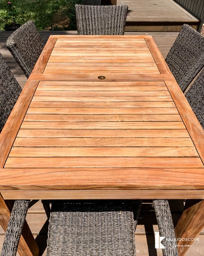 outdoor teak table after being restored