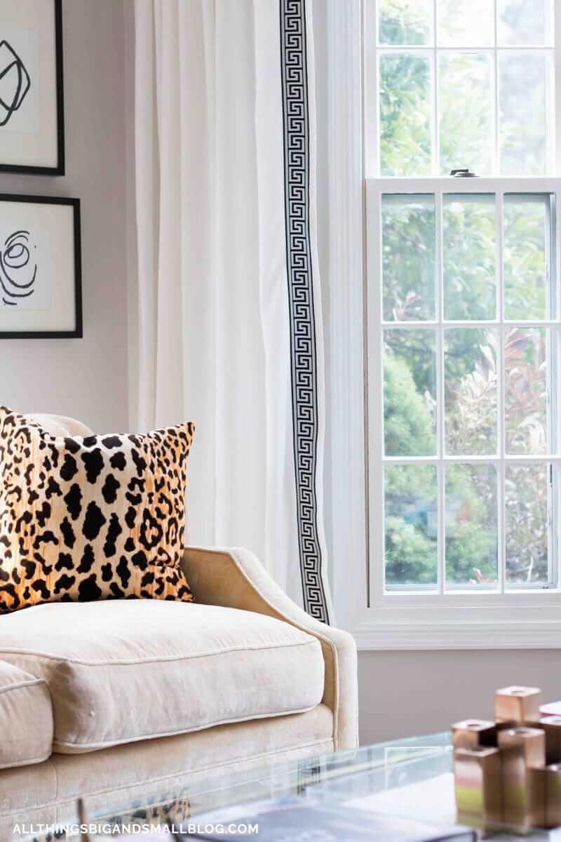 greek key curtains in neutral room