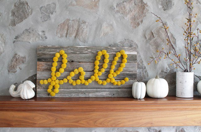 pompom and reclaimed wood sign