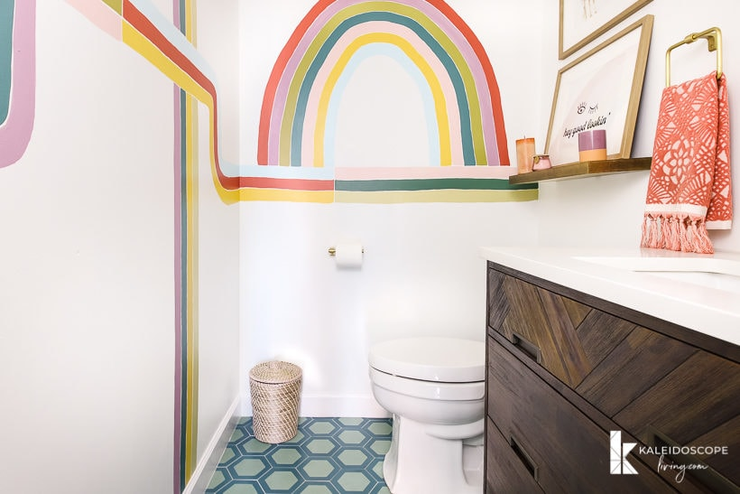 colorful powder room with cement tile and wall mural