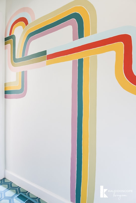 colorful hand-painted wall mural in powder room