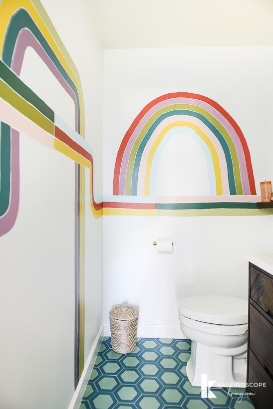 colorful powder room with wall mural