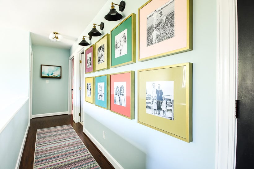 colorful photo gallery wall in hallway