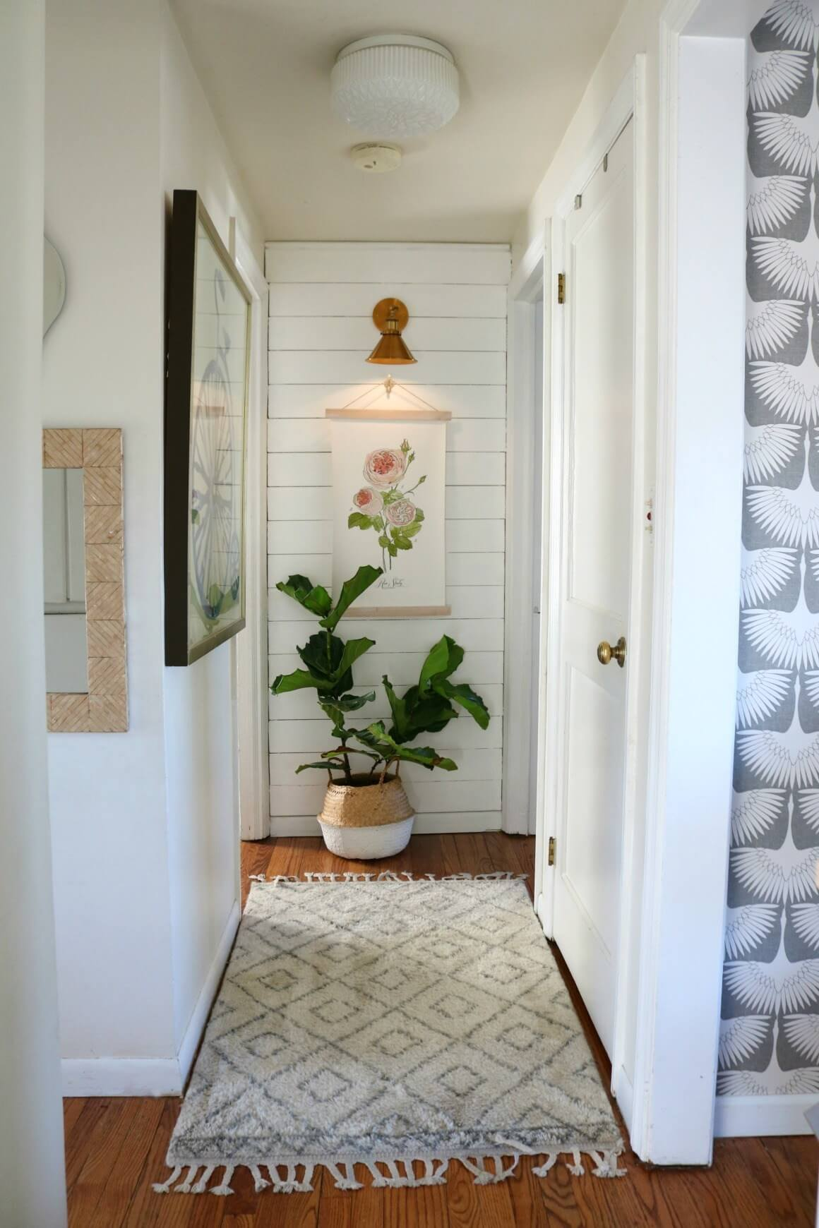 small hallway with shiplap