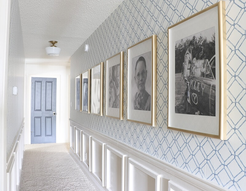 hallway with wallpaper and decorative molding