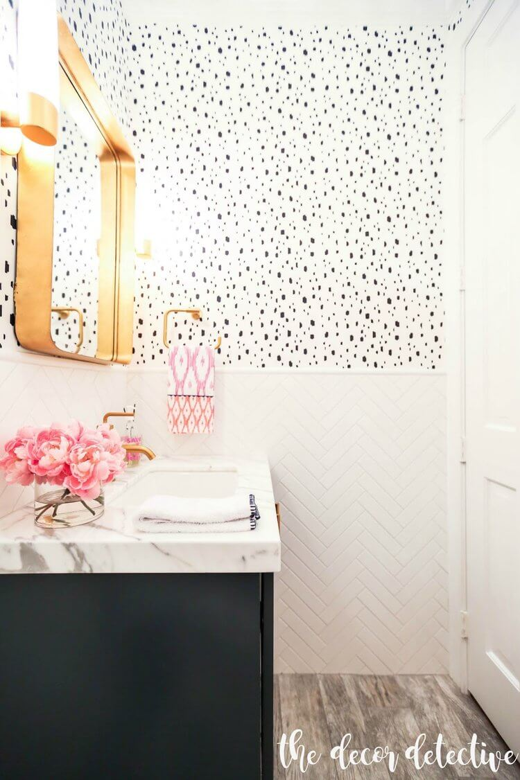 black and white bathroom with pink and gold pops
