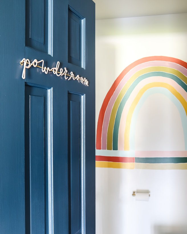 powder room with rainbow wall mural