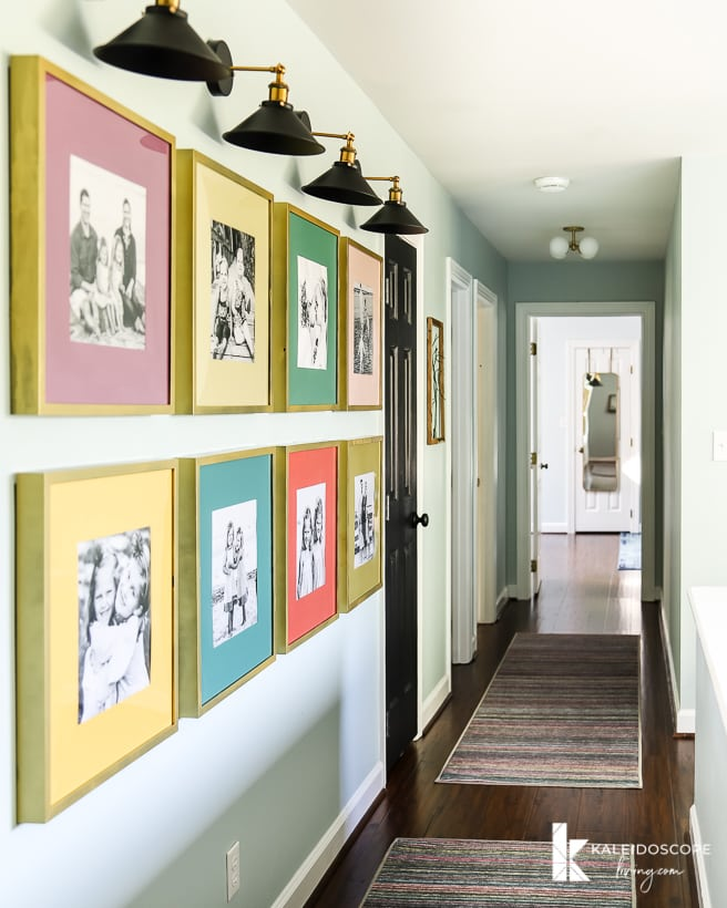 colorful photo gallery wall with sconces