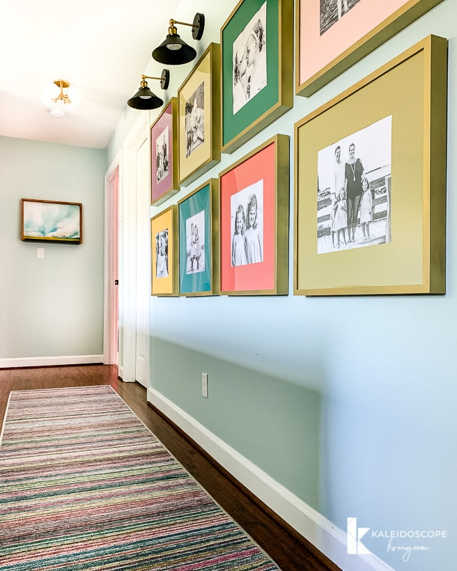 hallway with Ruggable runner and colorful frames