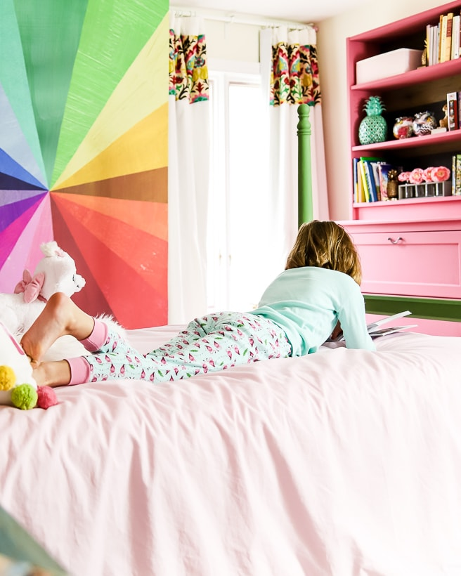 little girl in colorful bedroom