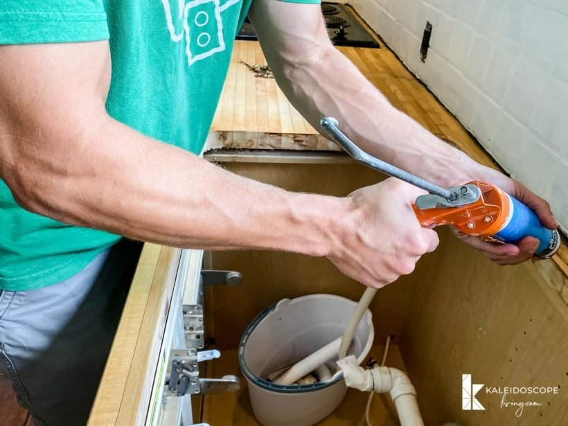 caulking before placing new sink