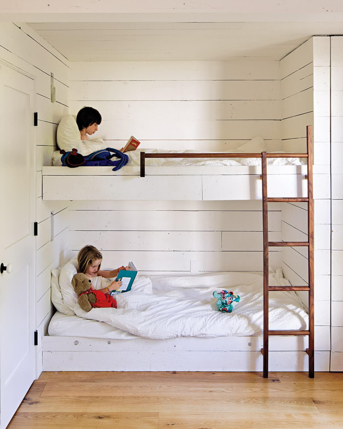 bunk beds and shiplap wall