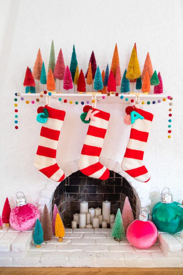 felted stockings and bottle brush mantel