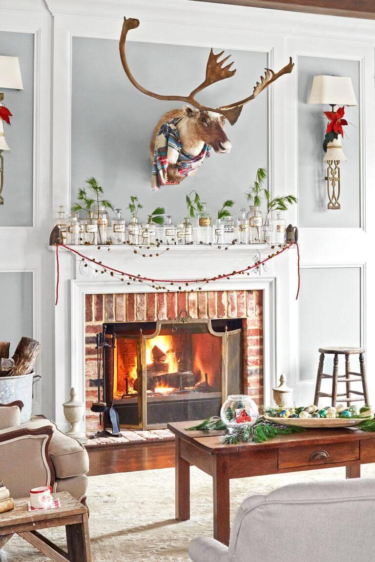 vintage bottles and berry garland mantel