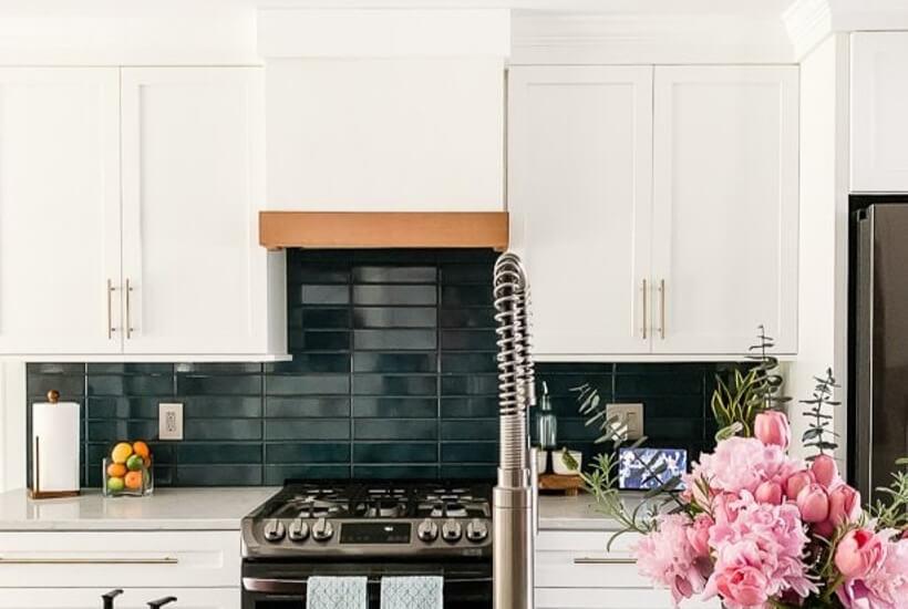 white kitchen with turquoise tile