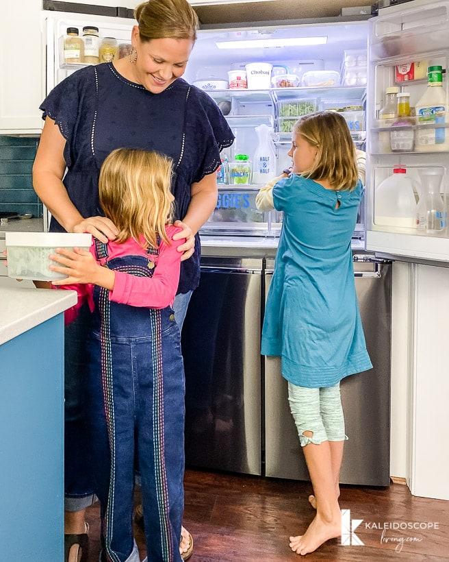 family using organized refrigerator