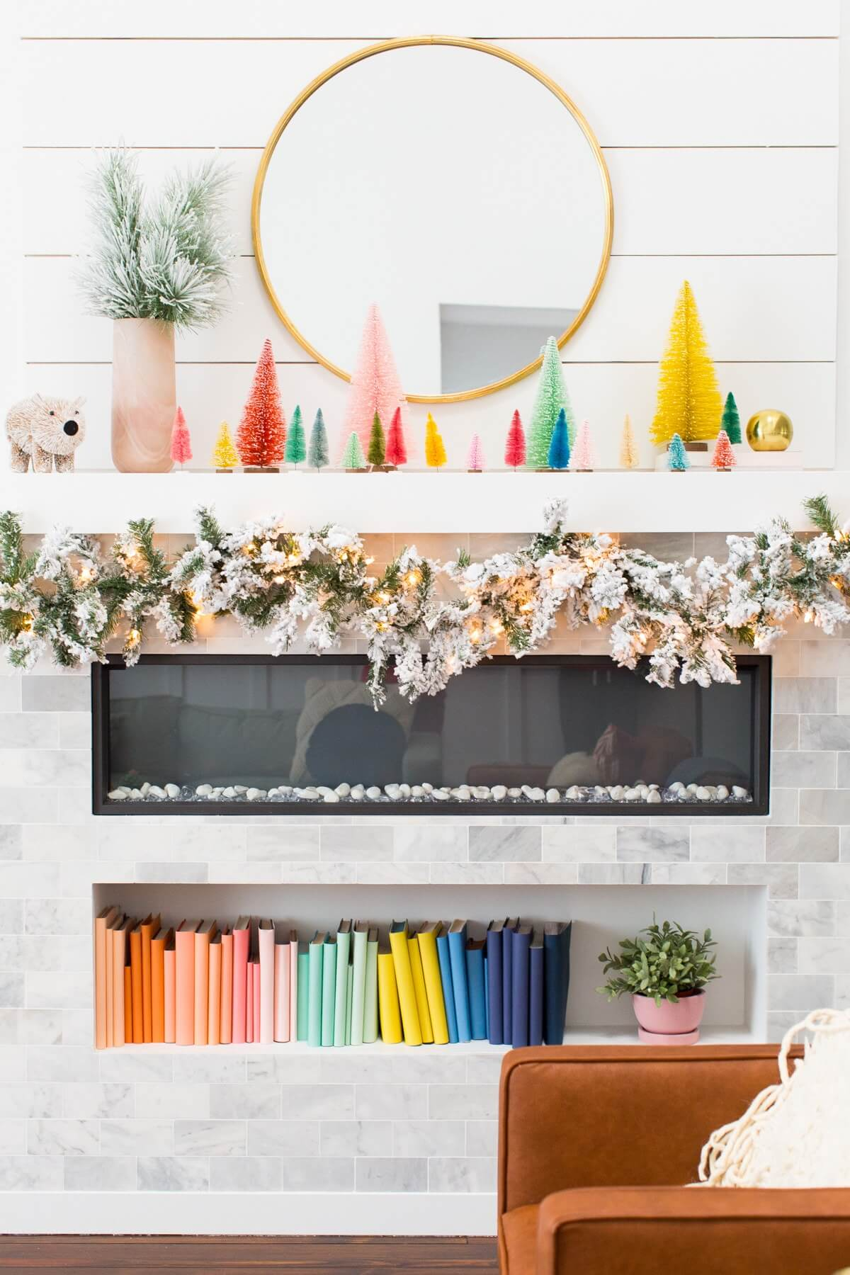 snowy garland and bottle brush mantel