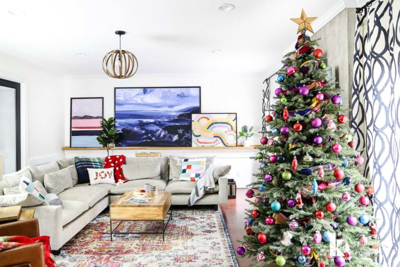 eclectic and modern family room with colorful christmas decorations