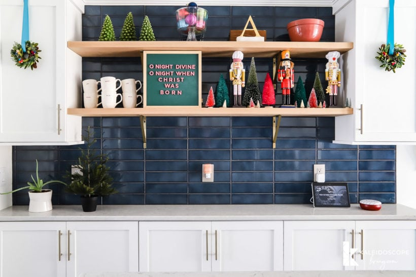 open kitchen shelved with colorful christmas decorations