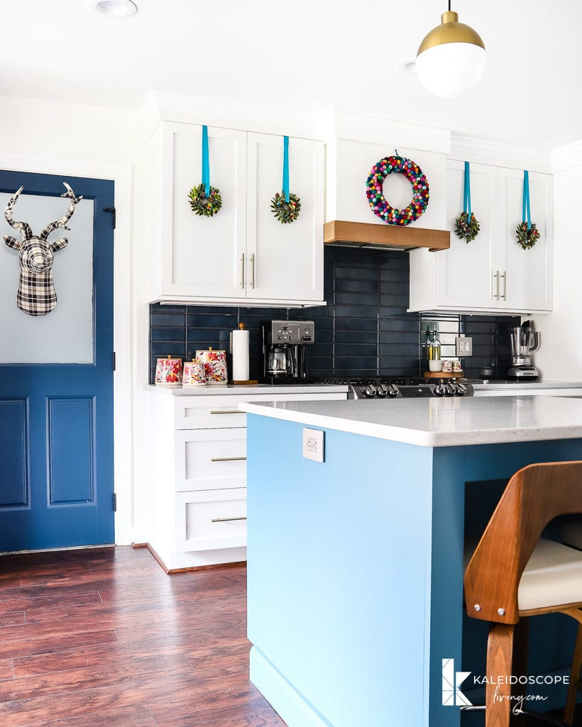 colorful christmas decorations in white and blue kitchen