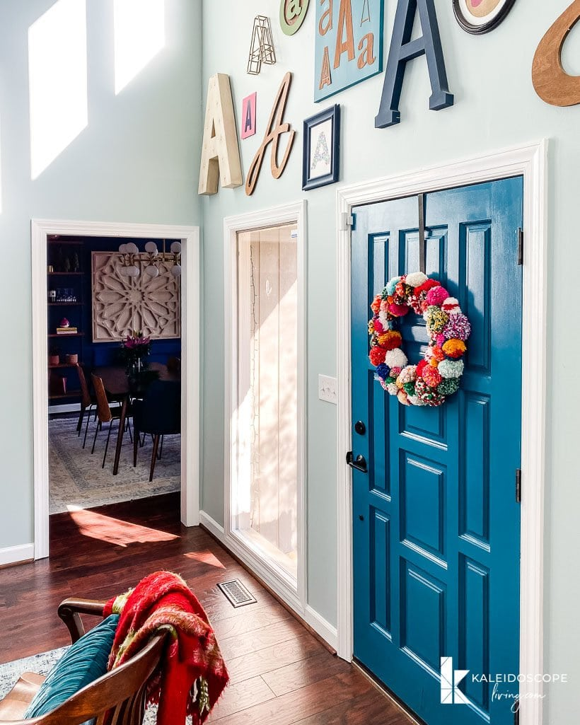 colorful typography wall and christmas wreath