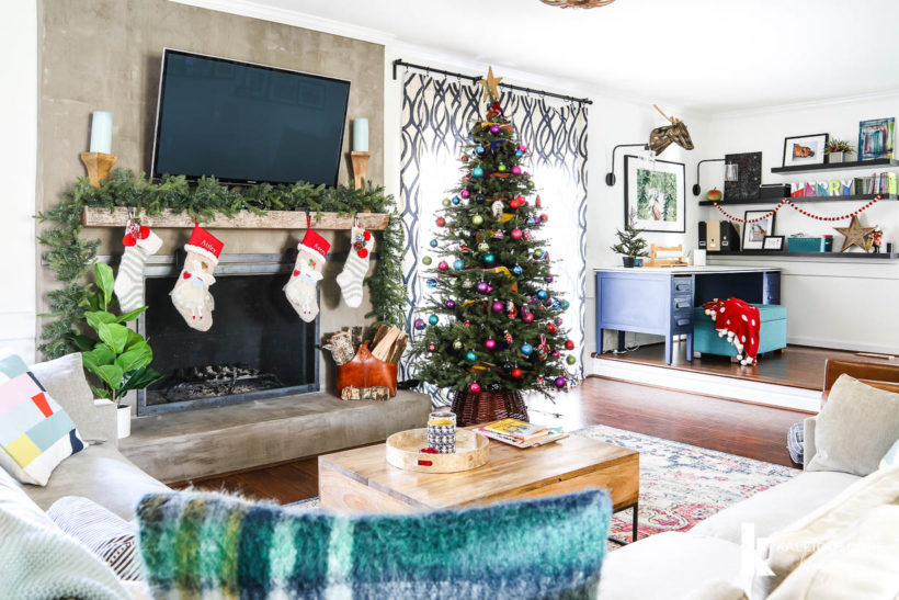 family room full of colorful christmas decorations