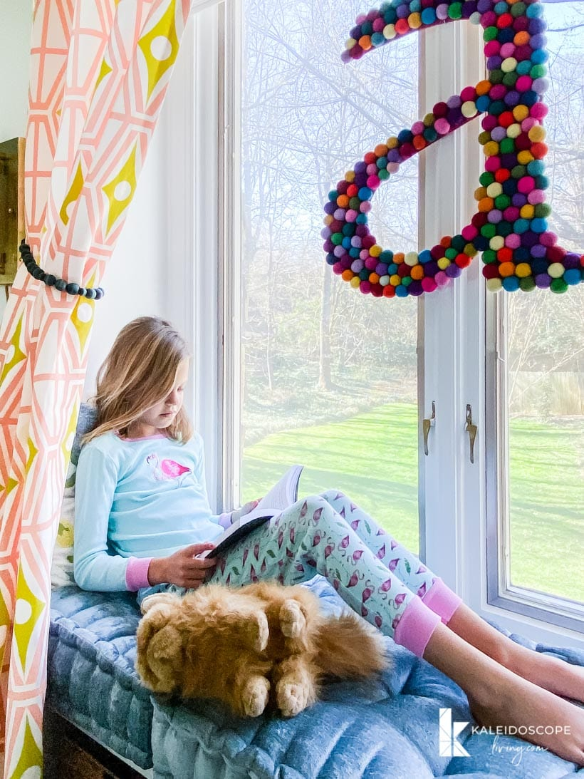 girl's window seat in colorful room
