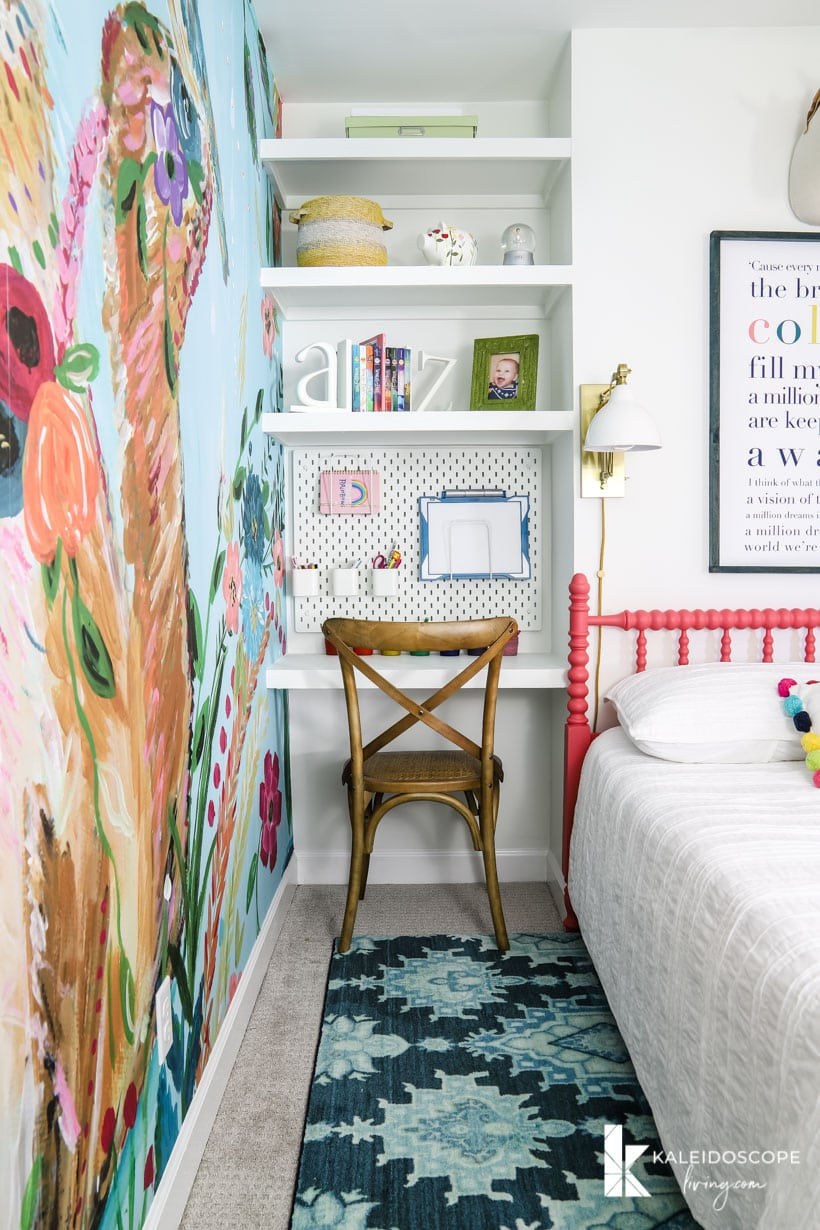 colorful girl's bedroom with built-in desk