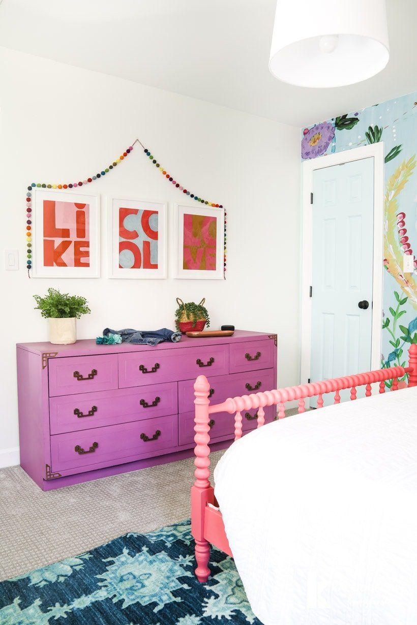 colorful girl's bedroom with purple dresser