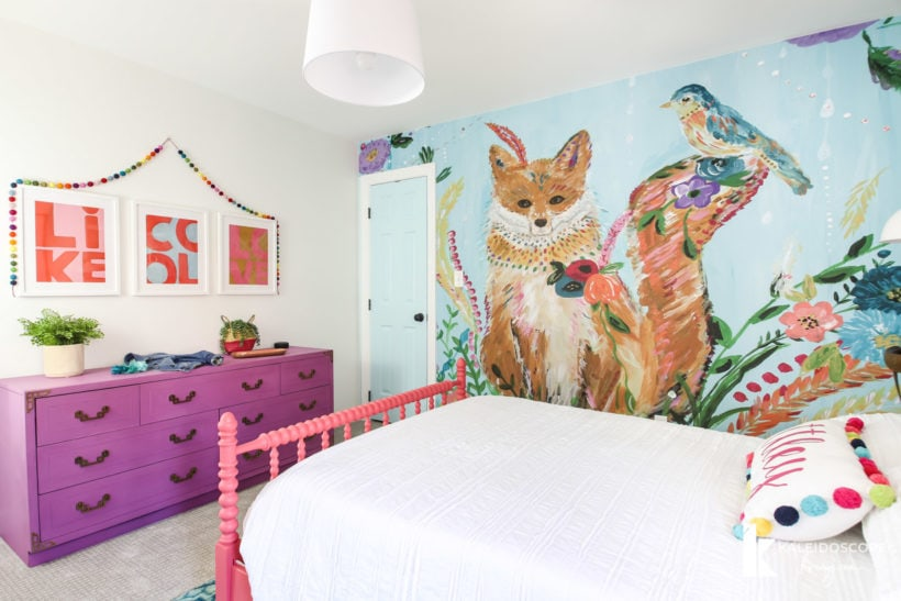 colorful girl's bedroom with wall mural