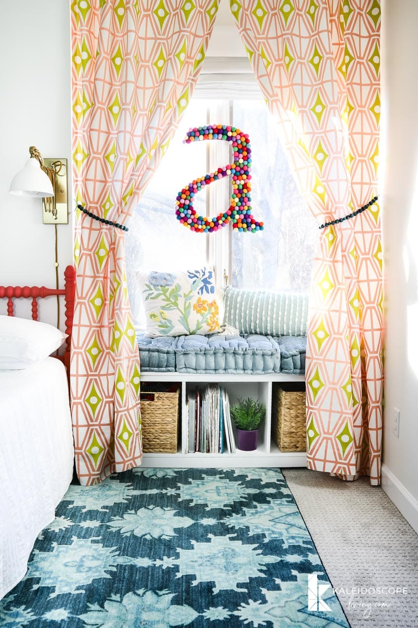 colorful girl's bedroom with window seat