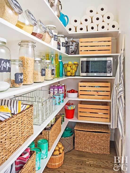 pantry with baskets and wooden bins