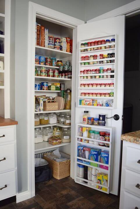 small pantry with door spice rack