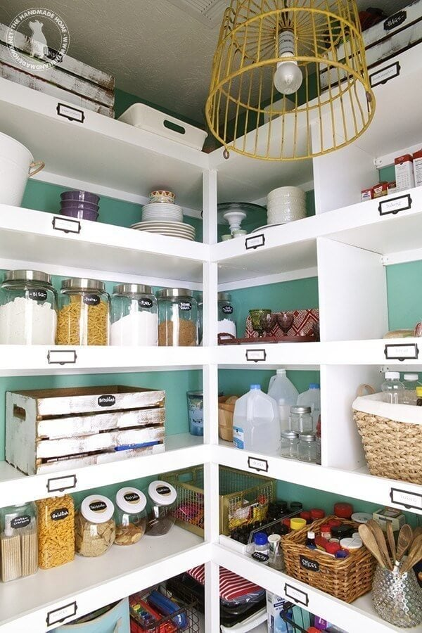 organized pantry with turquoise walls